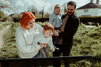 Family looking at sign on photoshoot in Hertfordshire